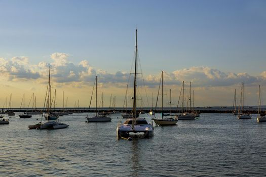 Amazing view to ocean bay with private yachts at sunset