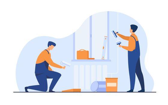 Renovation workers repairing apartment