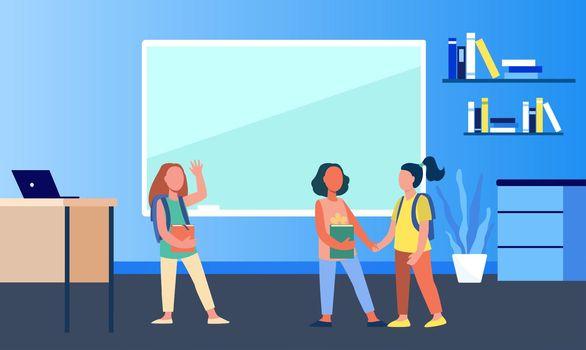 Schoolgirls meeting in classroom