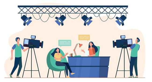 Videographers shooting interview in TV studio