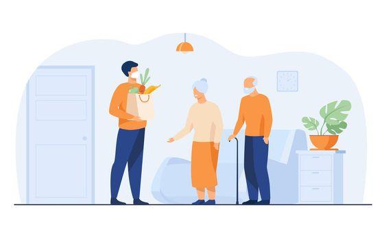 Volunteer delivering food parcels for elderly people