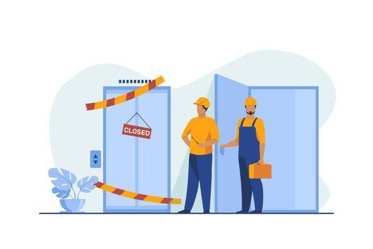 Workers in overalls standing near closed broken elevator