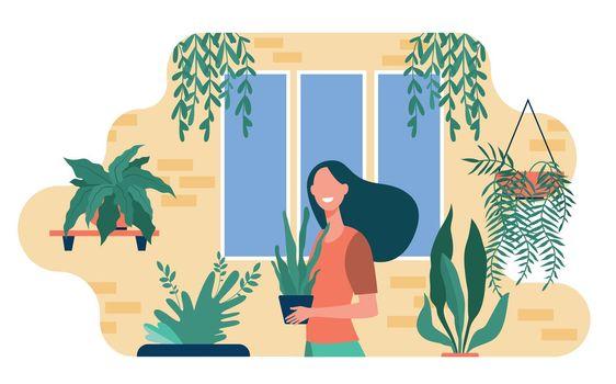 Happy woman growing houseplants