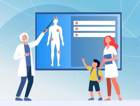 Physician explaining human anatomy to kid