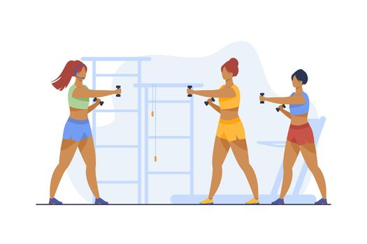 Women training with dumbbells in fitness club