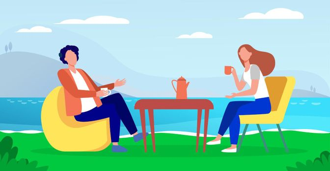 Young couple drinking coffee on lake shore