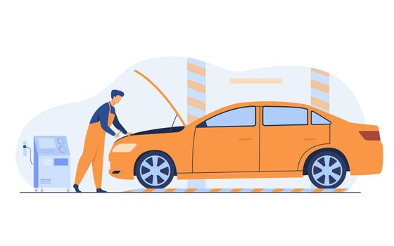 Auto mechanic repairing vehicle engine