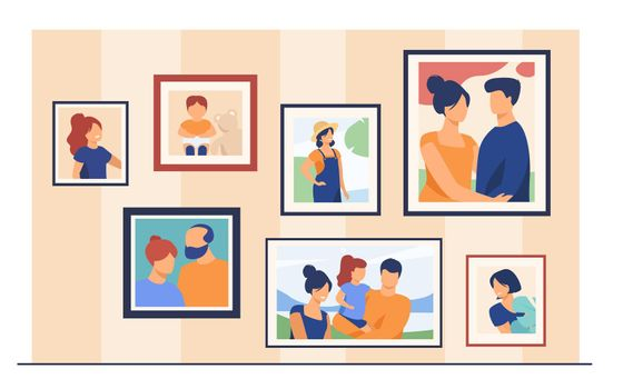 Family portrait pictures in frames on wall