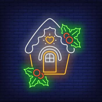 Gingerbread house with mistletoe neon sign