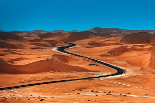 Beautiful Lands of an Orange Sandy Dunes and Lonely Highway. Travel Escape Destination. Liwa Desert. Abu Dhabi. United Arab Emirates.
