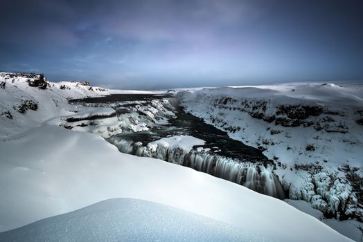 Amazing Landscape of a Beautiful Gullfoss. Snowy View of a Famous Icelandic Waterfall. Cold Winter Weather. Travel to Iceland.