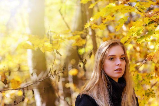 Portrait of attractive girl in park
