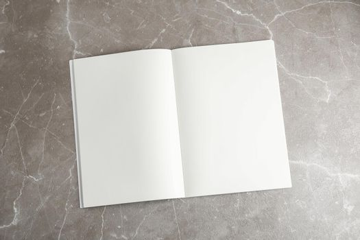 Clean copybook on grey table, space for text