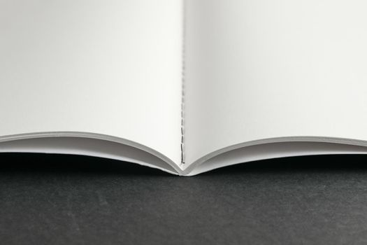 Clean copybook on black background, space for text