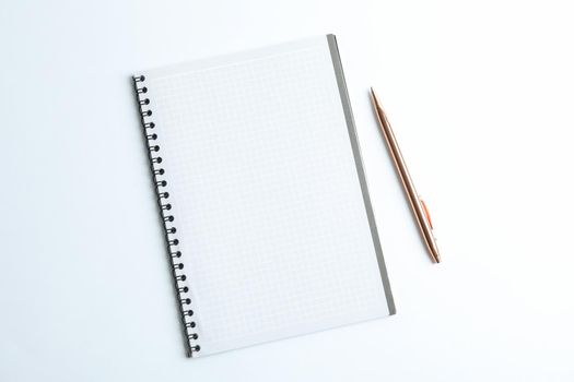 Clean copybook with pen on white background