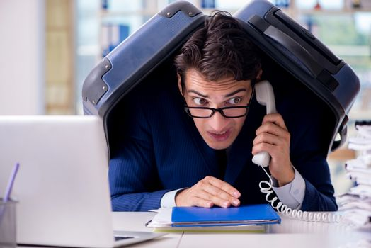 Employee thinking of vacation due to excessive workload