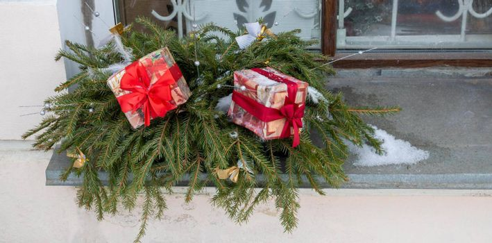 New Year's holiday Christmas showcase outside.Bright gifts on the window.