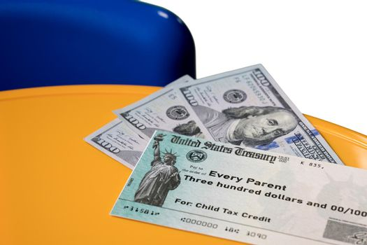 Illustration of the 2021 child tax credit check with cash due from the IRS in the summer