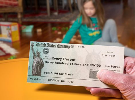 Illustration of the 2021 child tax credit check due from the IRS in the summer