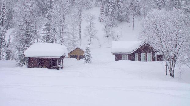 Snowfall in the skitouring lodge in Siberia