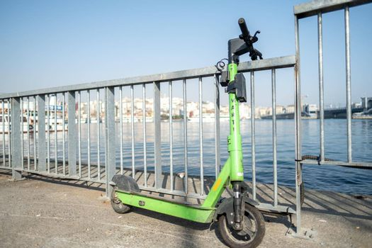 a green Marti scooter parked in coastal area of Eminonu, Istanbul
