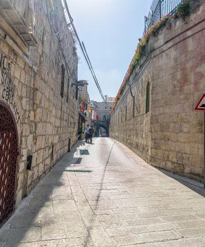 Ancient walls in Armenian street in Jerusalem Old City