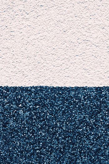 Duotone stucco wall texture as grunge background and urban detail