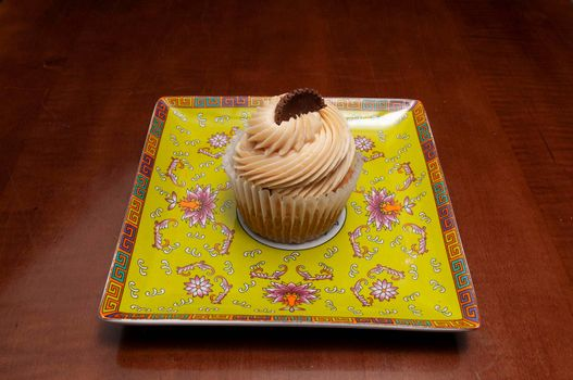 Delicious bakery product known as the vanilla peanut butter cupcake