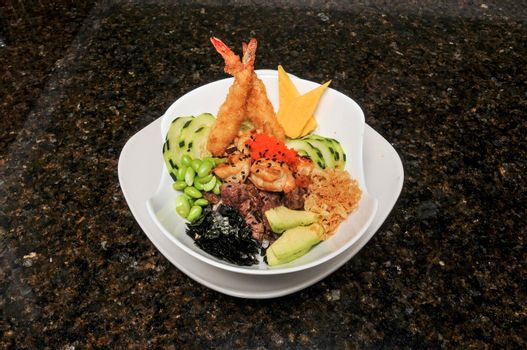Hawaiian dish known as hibachi steak chicken shrimp poke bowl