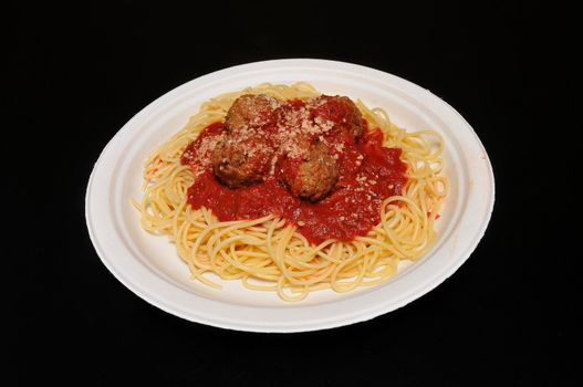 Heaping plate full of delicious spaghetti and meatballs