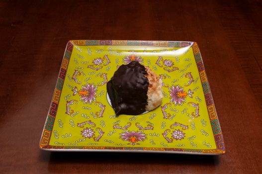 Delicious baked good known as the chocolate covered macaroon