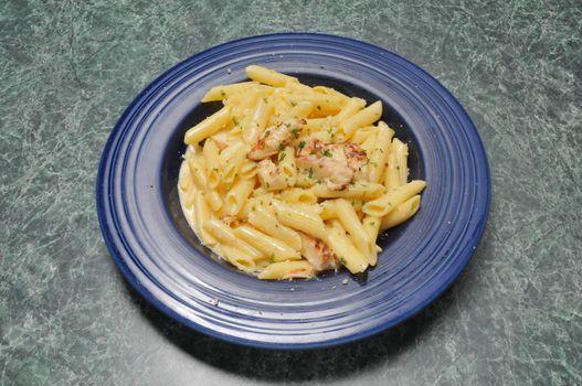 Traditional Italian cuisine dish known as chicken alfredo