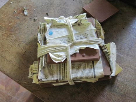 Old paper archives of abandoned power plant. old unnecessary paper.