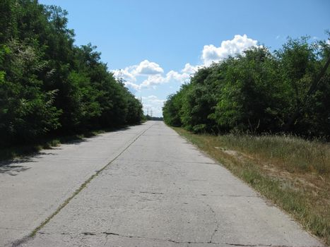 old road is made of concrete slabs. road surface slabs of concrete.