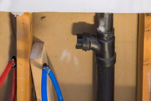 Repair of plastic polypropylene water pipes in hole in wall in home bathroom