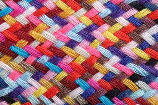 A braid of multi colored sewing threads, macro photography