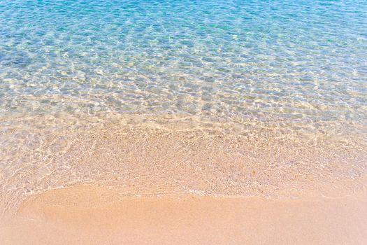 Clear blue transparent tropical summer beach water background