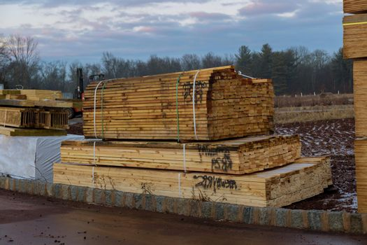 Stack of group in new construction materials for buildings on lumber material for construction