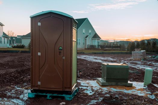 Portable restroom on house under construction in construction site for worker