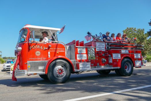 Old Firetruck and people at the July 4th Independence Day Parade in Rancho Bernardo, San Diego