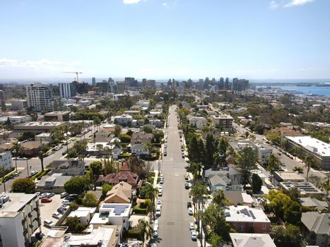 Aerial view above Hillcrest neighborhood with downtown San Diego on the background
