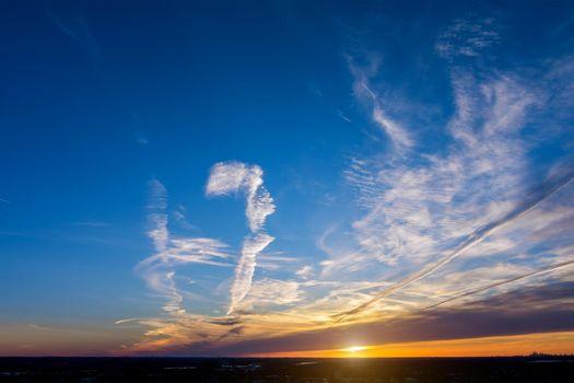 Colorful dramatic sunrise with clouds sky bright horizon burning skies morning idyllic scene