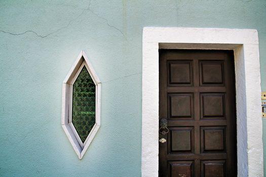 Wooden door and diamond shaped window