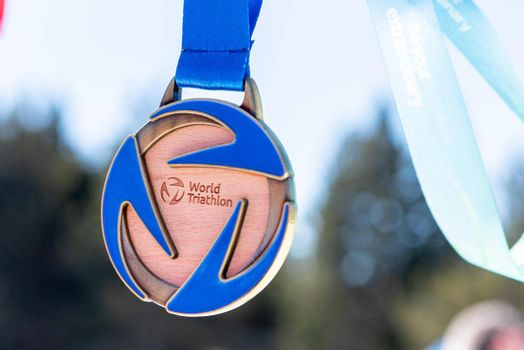Naturlandia, Andorra : 2021 March 20 : Medals to the winners in the 2021 World Triathlon Winter Championships Andorra