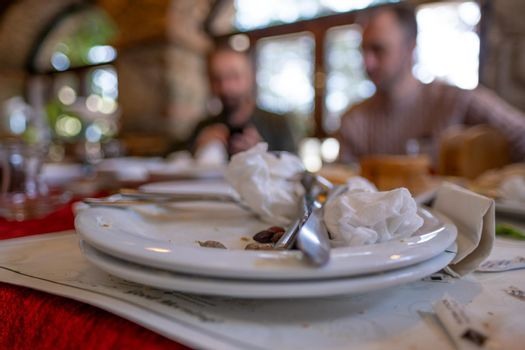 empty dirty plates after people finished their meals in breakfast in a restaurant in town