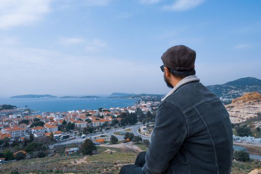 young male person spectate the view of Foca region of Izmir