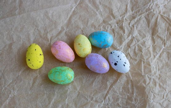 Colorful Easter eggs lie on crumpled paper.Easter Concept.