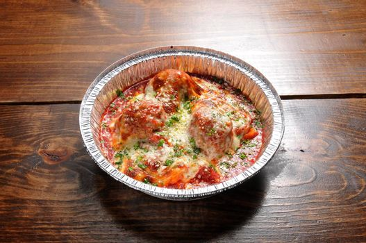 Authentic Italian cuisine known as meatball parmesan
