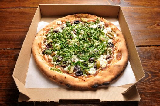 Delicious goat cheese hot and tasty pizza pie