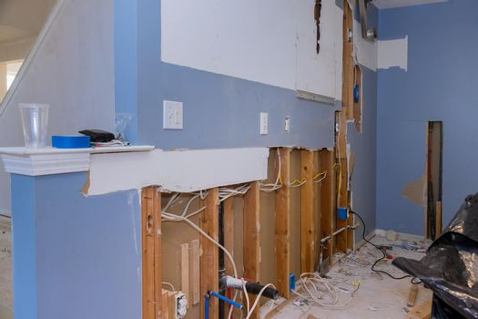 Demolition walls from gypsum plasterboard drywall with material for repairs in an kitchen is under construction remodeling, renovation.